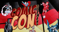 Das Banner der Comic Con Germany 2016 auf dem großen Bildschirm der Halle 3